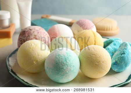 Plate With Colorful Bath Bombs On Table, Closeup