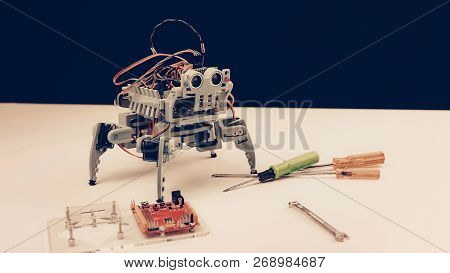 Close Up. Small Gray Robot With Tools On Table. Modern Technology. Robot Engineering Concept. Modern