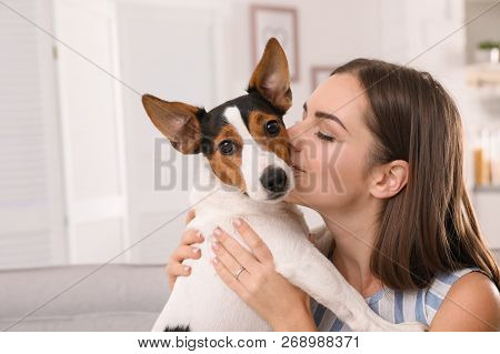 Beautiful Woman Hugging Her Dog At Home