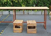 Temporary wood table and stool at street food. Thailand. poster