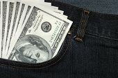 Jeans with money in a pocket poster