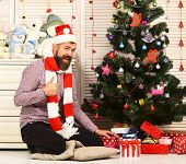 Santa Claus with excited face near bureau and Christmas tree poster