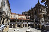 The Hostelry Cloister built in early 16th century specifically to provide temporary accommodation for guests and pilgrims of St James, in the Convent of Christ, Tomar, Portugal poster