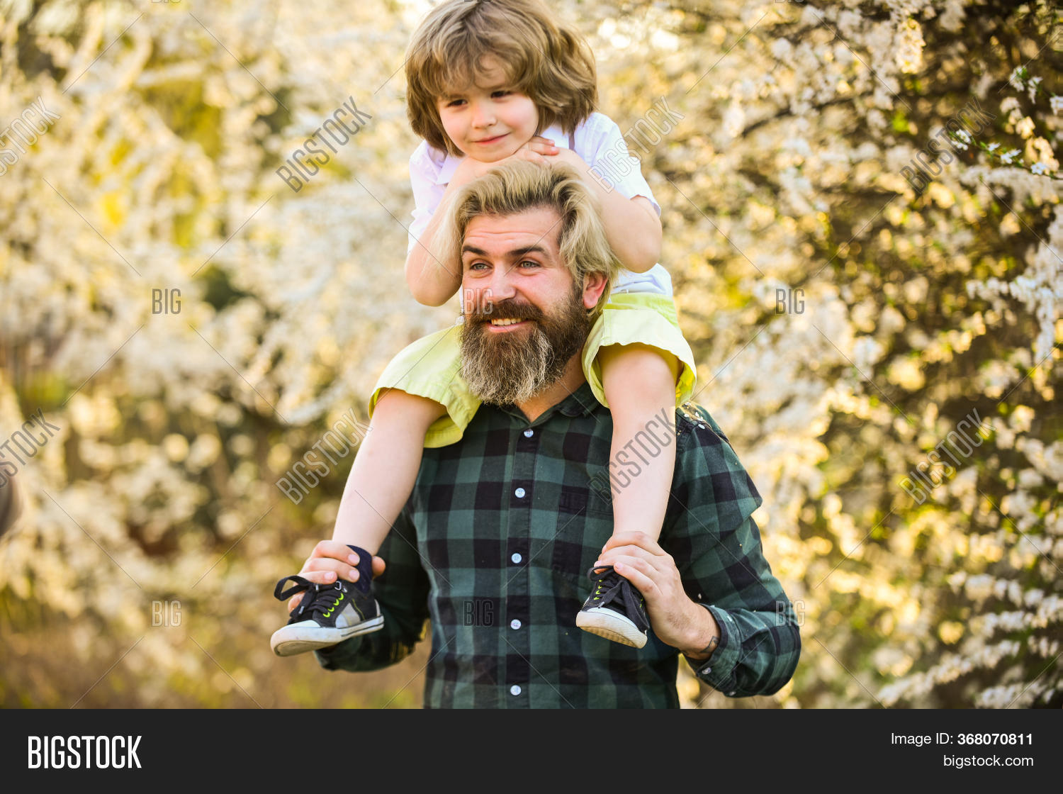 Earth Day. Little Boy And Father In Nature Background. Hipster And Baby Son. Happiness Concept. Spri