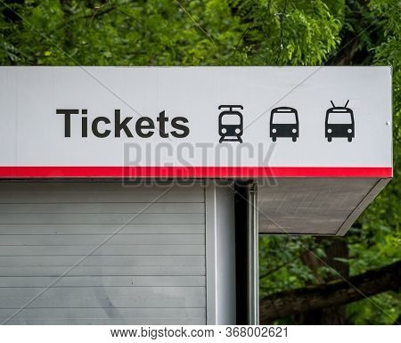 Close Up With A Public Transport Tickets Booth. Bus, Tram And Trolleybus Symbols On A Service Booth.