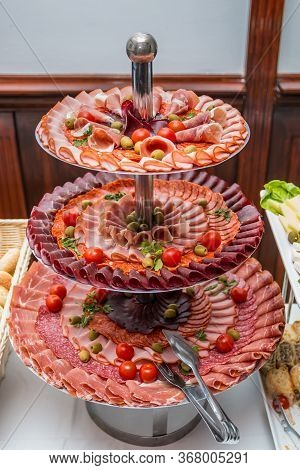 Various Types Of Meat On The Three Tier Serving Tray. Close Up.