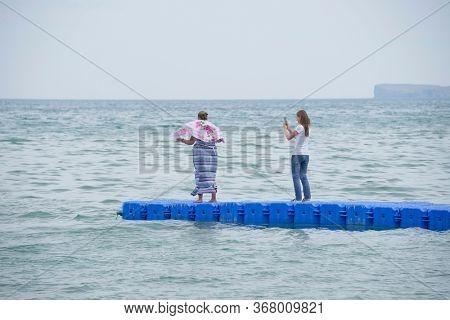 OLKHON ISLAND, 27 AUGUST, 2019: Tourists traveling on Olkhon Island, Baikal Lake, Siberia, Russia