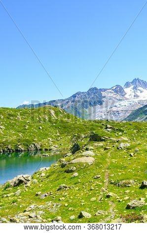 Alpine Lac De Cheserys, Lake Cheserys Near Chamonix-mont-blanc In French Alps. Glacier Lake With Hig