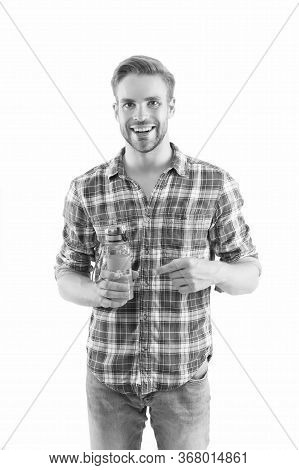 Man Hold Water Bottle Or Sport Drink White Background. Bottle In Hand. Sport And Water Balance Conce
