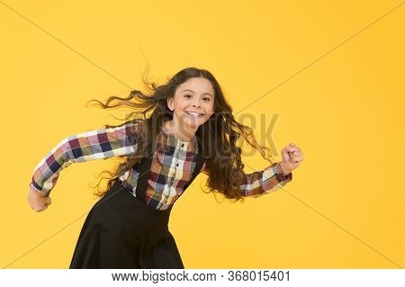 Activity School. Energetic Child Hurry To School. Small Child Wear School Uniform Yellow Background.