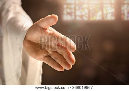 Gods or Jesus Christ hand reaching out, religion, salvation, forgiveness,  atonement and love concept