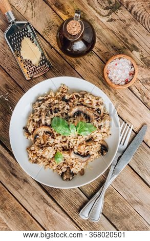 Homemade Traditional Italian Mushroom Risotto On Rustic Wooden Background. Classic Risotto With Mush