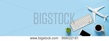 Keyboard, Flower, Airplane, Cup With Tea Or Coffee, A Blank Sheet And A Pencil On A Blue Background.