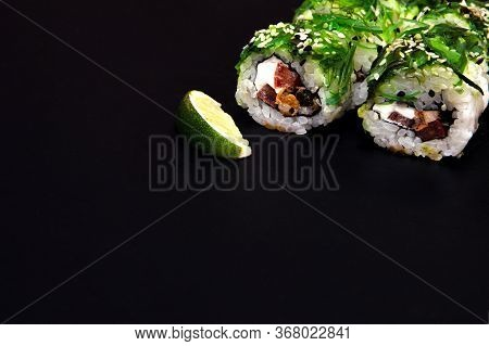 Sushi Rolls With Seafood And Chuka Salad. Green Sushi. Free Space For Your Text.
