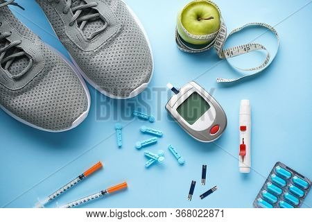 Sports Diabetic. Digital Glucometer. Concept Of A Healthy Diabetic On Blue Background. Flat Lay.