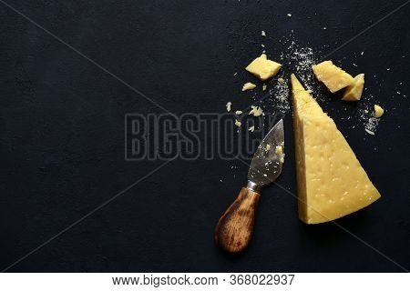 Block Of Parmesan Chees With Knife.