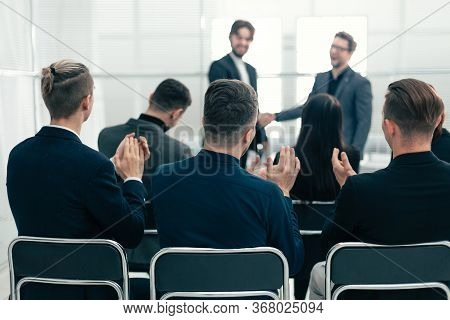 Working Group Applauding Business Partners During The Meeting