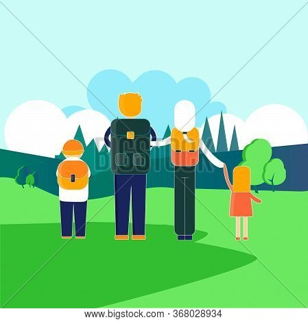 Family Hiking Outdoors. Father, Mother, Son And Daughter Traveling Trekking With Backpacks In Forest