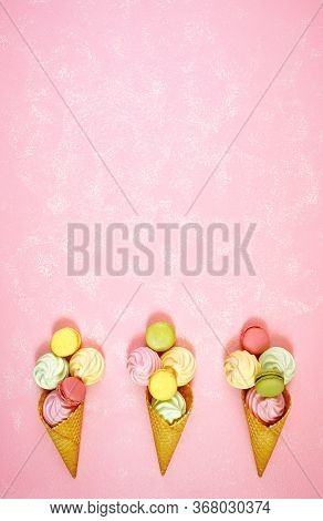 Summertime Decorated Border Of Ice Cream Cones With Macarons And Meringues.