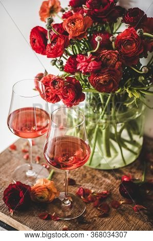 Rose Wine In Glasses And Red Spring Flowers