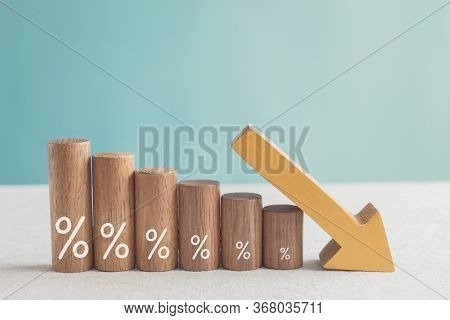 Wooden Blocks With Percentage Sign And Down Arrow, Financial Recession Crisis, Interest Rate Decline