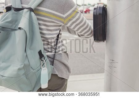 Young  Preteen Tween Teen Boy Student Using His Elbow Pressing Traffic Light Button Due To Covid-19
