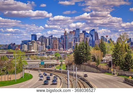 A Vibrant Cloudy Sky Over The Downtown Calgary Skyline