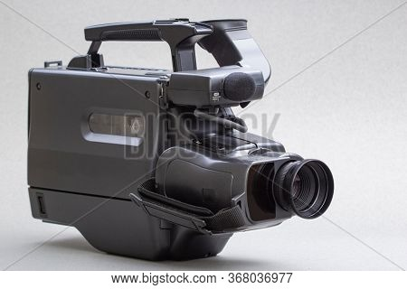 video camera with the microphone, in concept of technology, entertainment. Retro camcorder