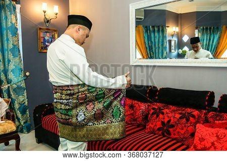 Labuan,malaysia-may 24,2020:malaysian Muslim Man In Traditional Attire Called Baju Melayu Ready To C