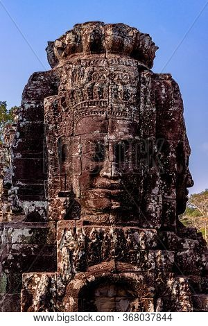 Stone Reliefs Head On Towers At The Bayon Temple In Angkor Thom