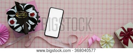 Pink Scott Pattern Background With Mock-up Smartphone, Cake, Decorations And Copy Space