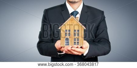 House Residential Structure In Hand.  Concept Of Investment Propert And Finance Investment Concep