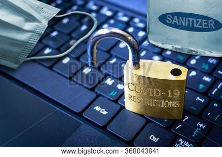 Covid-19 Coronavirus Lockdown Restrictions Ease Concept Illustrated By Unlocked Padlock On Laptop Wi