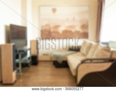 Blurred Living Room Background, Sofa Tv Picture Acoustics. In Warm Colors.