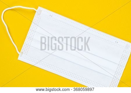 Medical Mask Or Surgical Mask With Rubber Ear Straps. Typical 3-ply Surgical Mask To Cover The Mouth