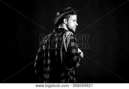 Countryside. Vintage Style Man. Wild West Retro Cowboy. Cowboy With Lasso Rope. Western. Man Checker