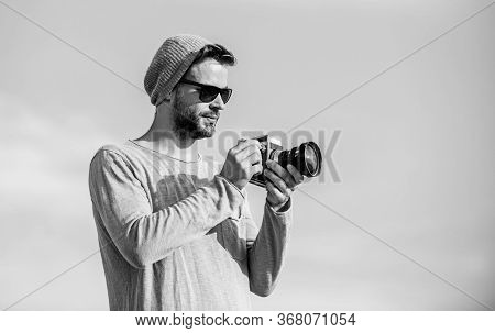 Photojournalist Concept. Guy Photographer Outdoors Sky Background. Hipster Reporter Taking Photo. Ma