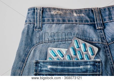Two Packages Of Blue Capsules In The Pocket Of His Pants.pills For Mens Health And Sexual Energy In