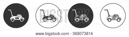 Black Lawn Mower Icon Isolated On White Background. Lawn Mower Cutting Grass. Circle Button. Vector