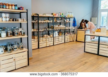 Zero Waste Shop Interior Details. Wooden Shelves With Different Food Goods And Personal Hygiene Or C