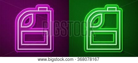 Glowing Neon Line Canister For Motor Machine Oil Icon Isolated On Purple And Green Background. Oil G
