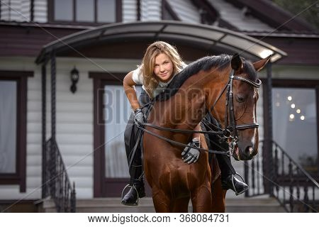 Portrait Of A Pretty Young Girl With A Browne Horse