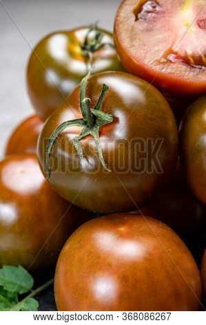 Fresh Ripe Sweet Reddish Brown And Green Kumato Tomatoes