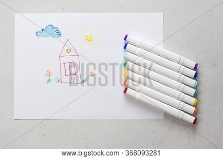 Drawn By Colorful Felt-tip Pens A Child's Drawing On A White Sheet Of Paper - A House, Flowers, The