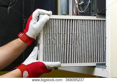 Replacing The Filter In The Central Ventilation System. Replacing Dirty Air Filter For Home Central