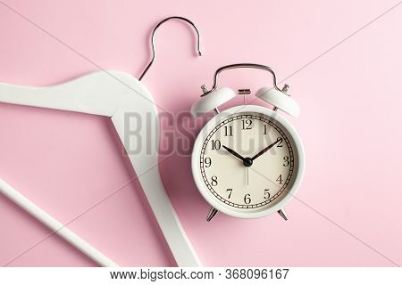 Alarm Clock, Clothes Hanger Pink Background. Concept Of Shopping, Shopping For Clothes, Discounts, S