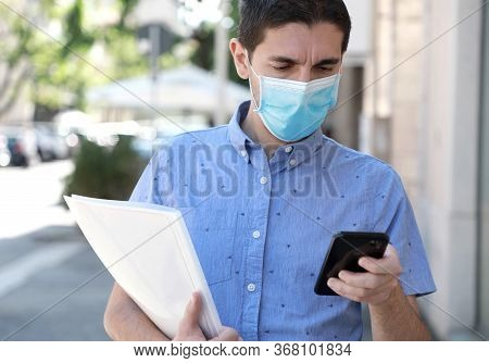 Covid-19 Global Economic Crisis Unemployed Man With Surgical Mask Looking For Work With Job Recruiti