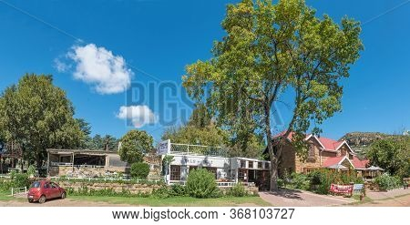 Clarens, South Africa - March 18, 2020:  Panoramic Street Scene, With A Car, Restaurant And Guest Ho