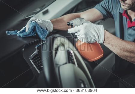 Automotive Maintenance Theme. Car Interior Dashboard And Cockpit Disinfection And Detailed Cleaning.