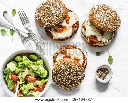 Served Appetizers Table - Homemade Whole Grain Bun, Grilled Chicken Patty, Tomato Sauce, Mozzarella